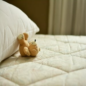 Matress and pillow with a stuffed bear
